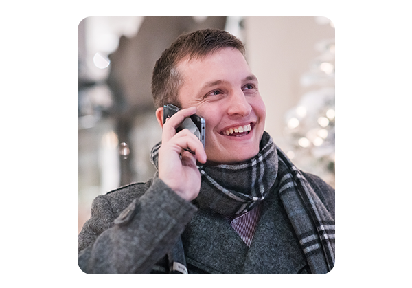 Man laughing while speaking on the phone